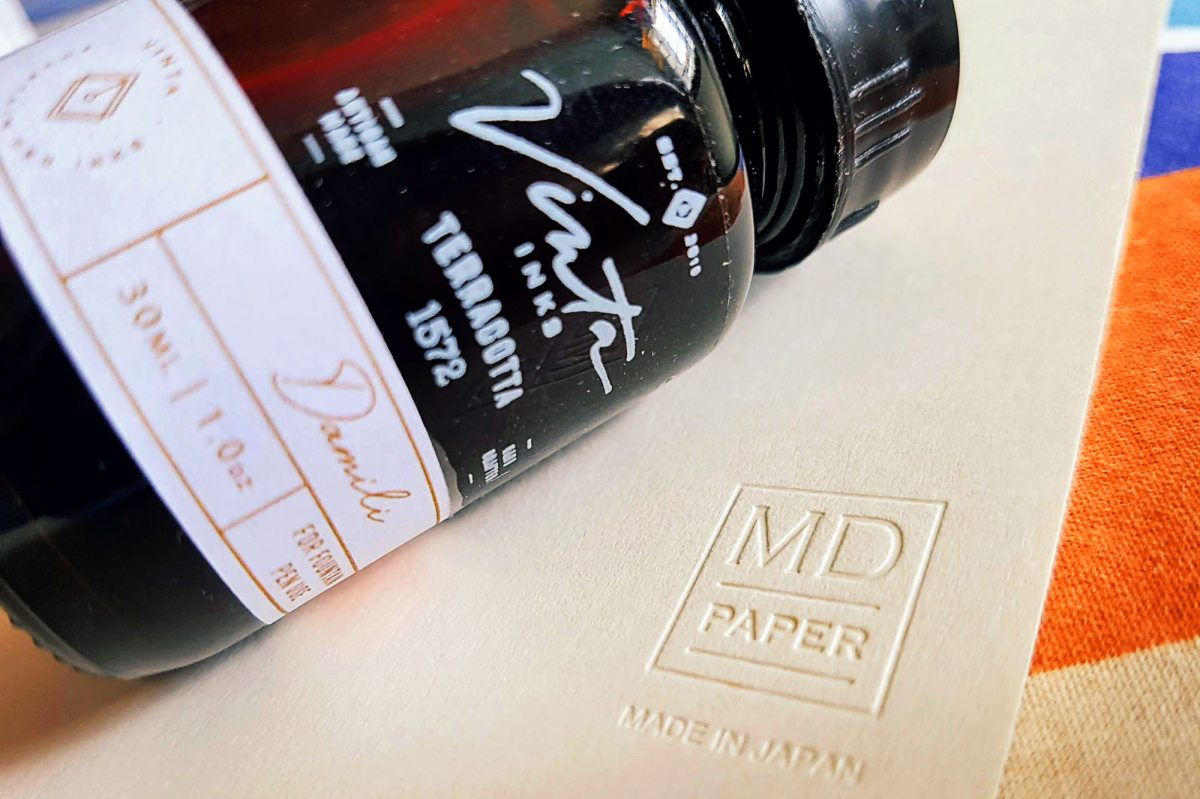 Bottle of Vinta Terracotta ink and Midori MD notebook