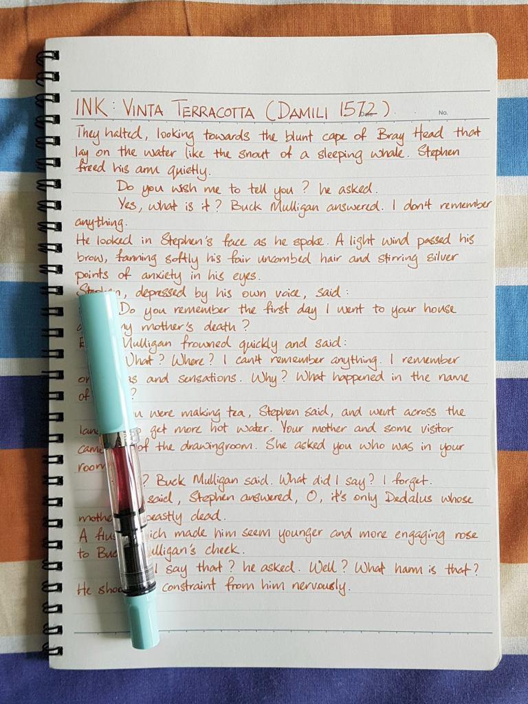 Writing sample of  Vinta Terracotta ink on Kokuyo Campus notebook