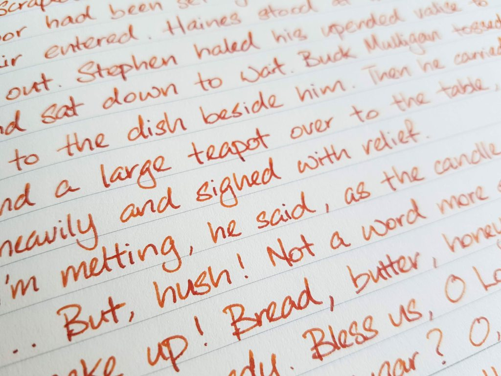 Writing sample of Monteverde Fireopal ink on Midori MD notebook