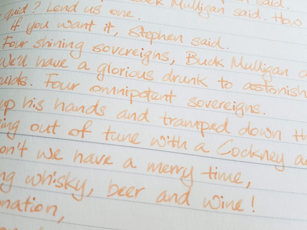 Writing sample of Van Dieman's Apricot ink on Midori MD notebook