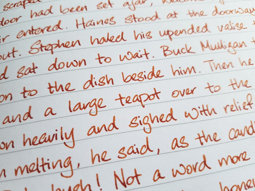 Writing sample of Monteverde Fireopal ink on Rhodia notebook