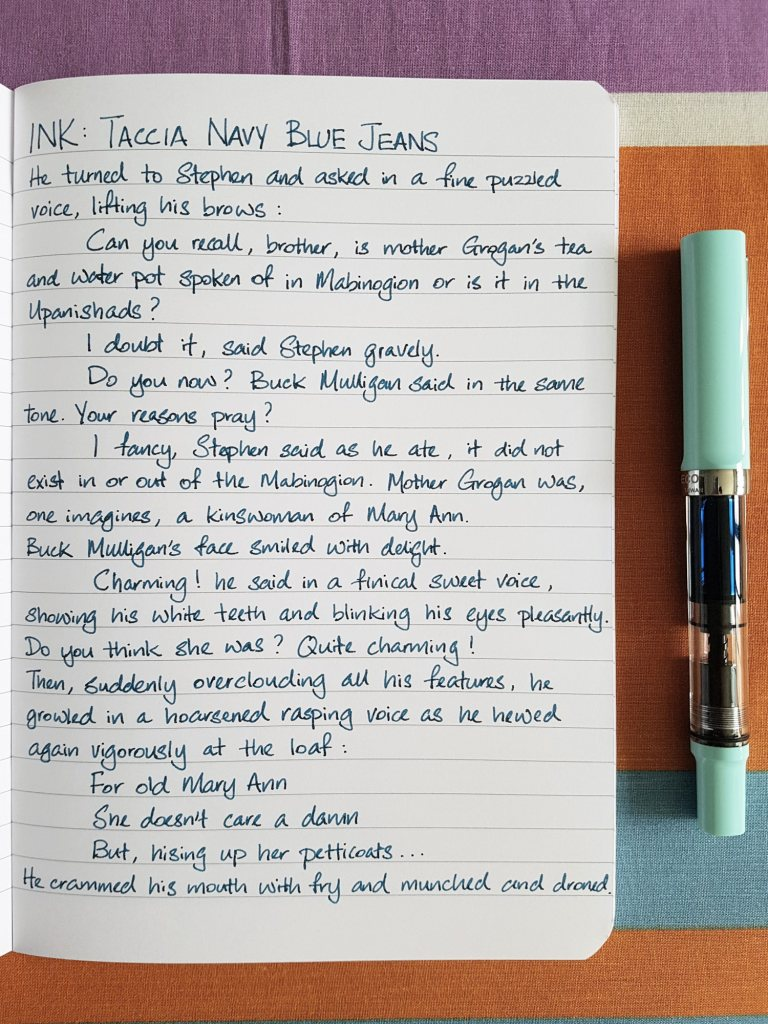 Writing sample of Taccia Navy Blue Jeans ink on Rhodia notebook