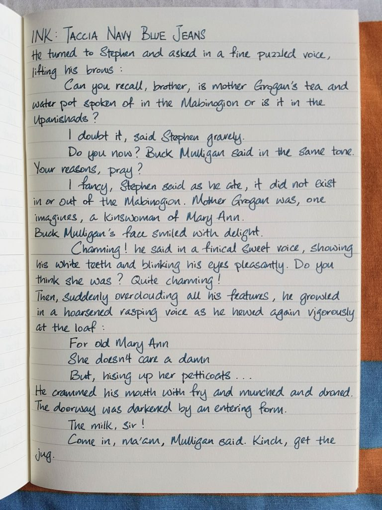 Writing sample of Taccia Navy Blue Jeans ink on Midori MD notebook