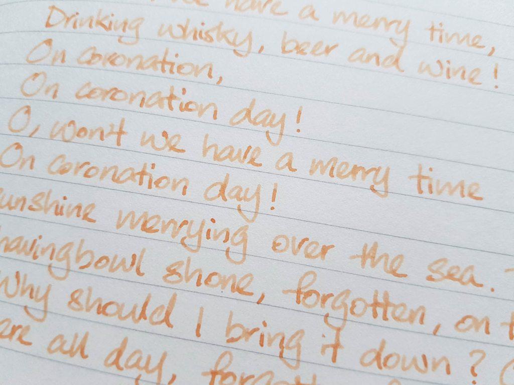 Writing sample of Van Dieman's Apricot ink on Traveler's Company notebook