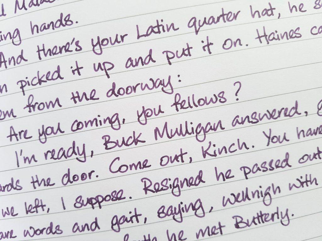 Writing sample of Birmingham Boysenberry ink on Rhodia notebook
