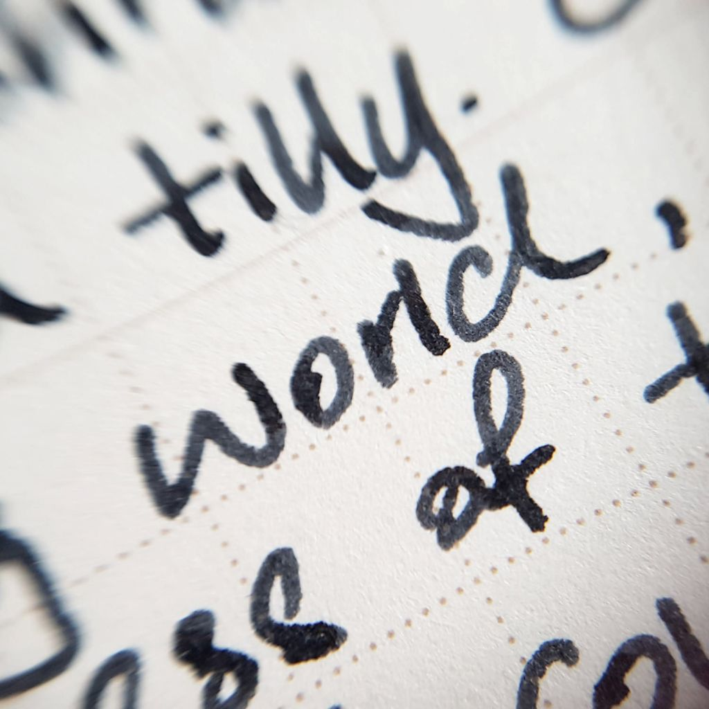 Writing sample of Taccia Black Jeans ink on WORLD CRAFT Freiheit notepad
