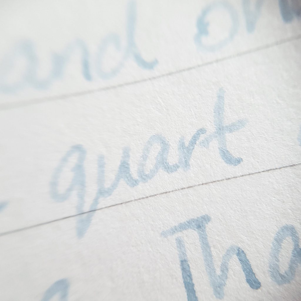 Writing sample of Taccia Grey Jeans ink on Traveler's Company notebook