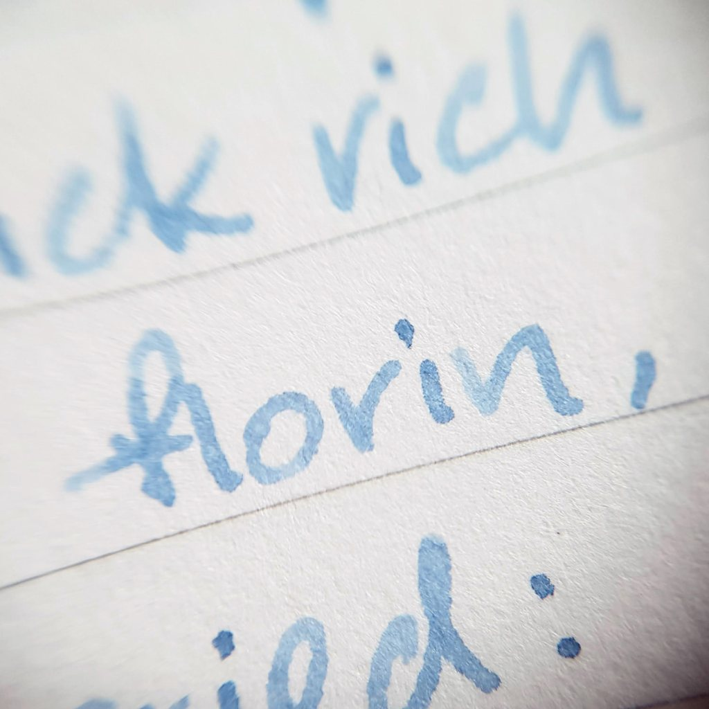 Writing sample of Taccia Light Washed Jeans ink on Traveler's Company notebook