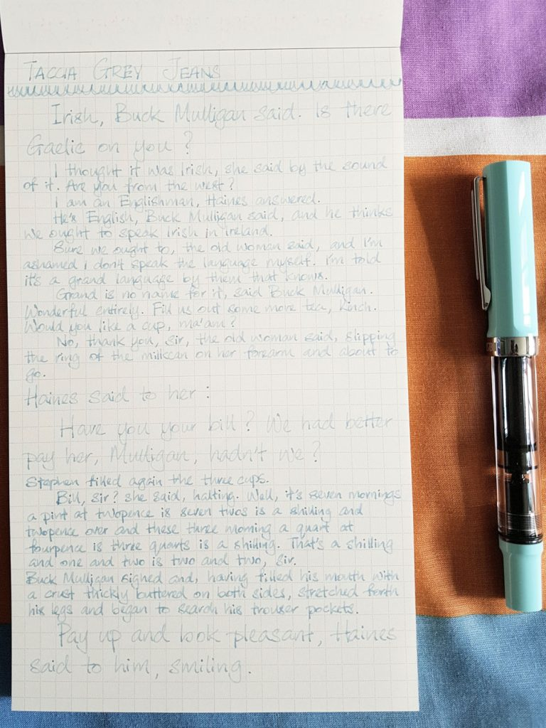 Writing sample of Taccia Grey Jeans ink on WORLD CRAFT Freheit notepad